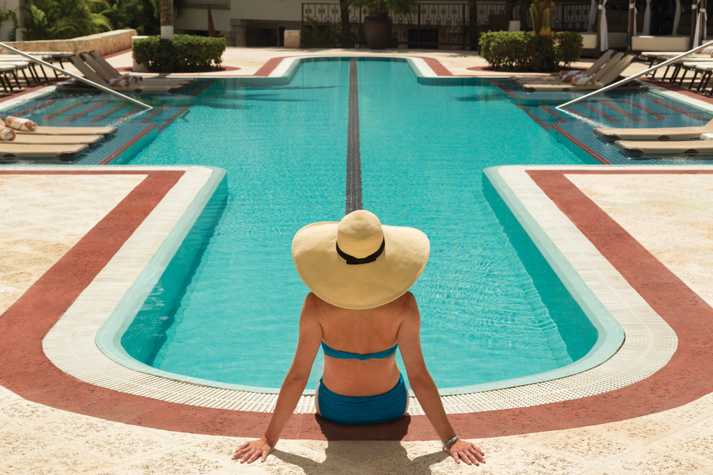 Hilton-Playa-del-Carmen-Tranquil-Pool-Woman