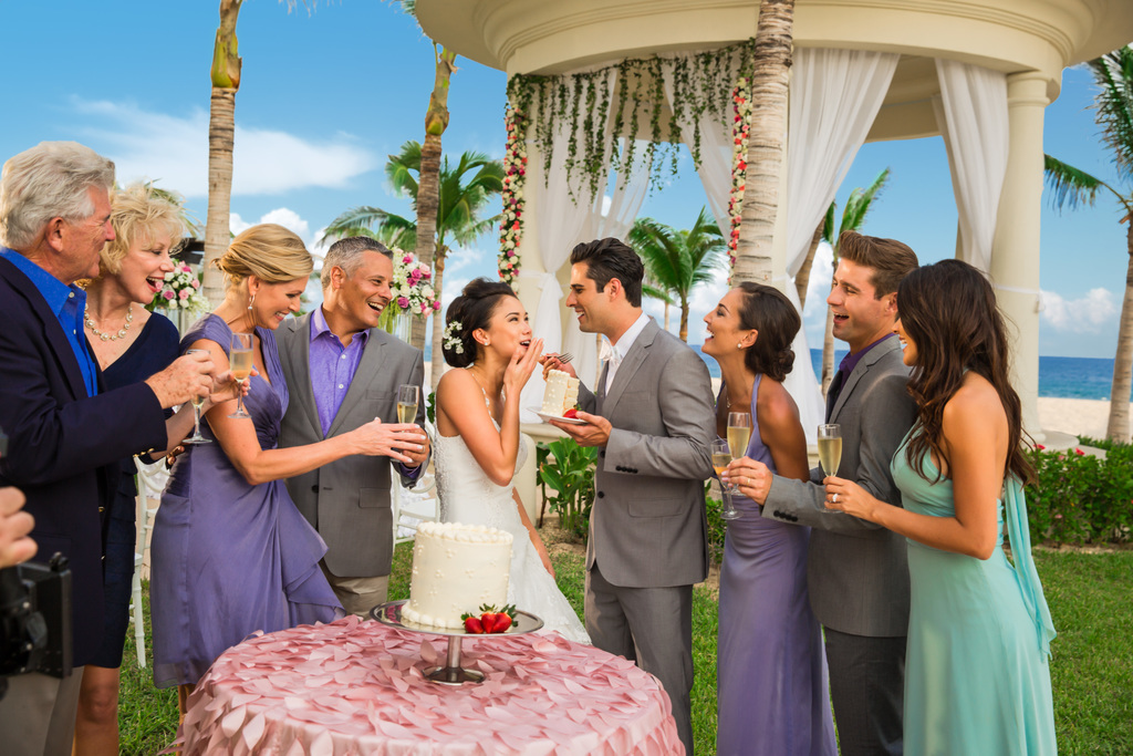 Hyatt-Ziva-Los-Cabos-Couple-Eating-Cake-And-Friends