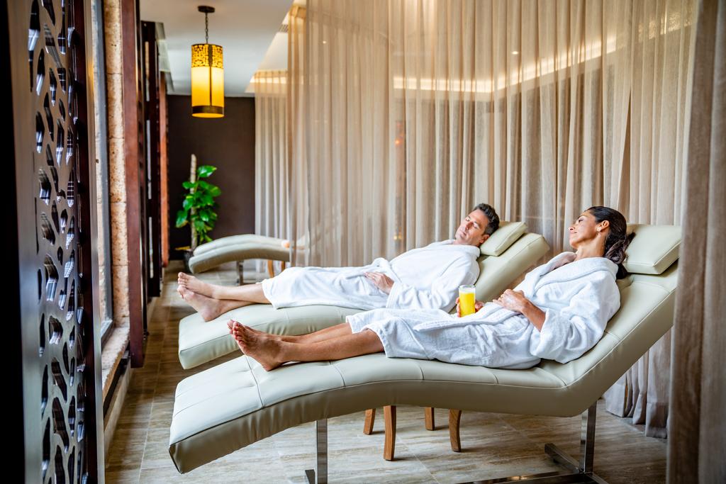 Sanctuary-Cap-Cana-Spa-Relaxation-Room-Couple.