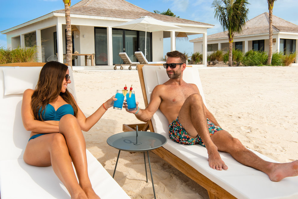 Ambergris-cay-couple-turks-and-caicos-resorts