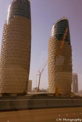 The Al Bahr Towers - Abu Dhabi They look like honeycombs to me. :-)