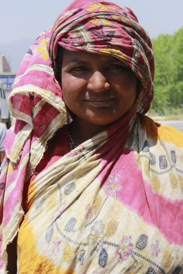 Women in sari around her head