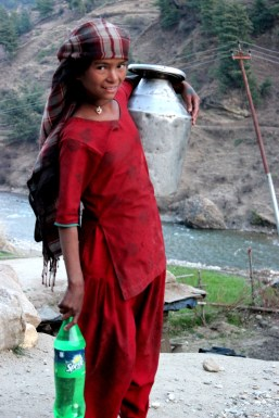 Fetching water from near river
