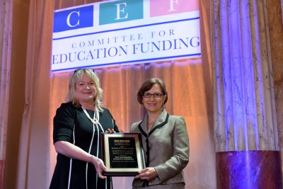CEF Treasurer Megan Wolfe presents the William H. Natcher Award to Rep. Suzanne Bonamici
