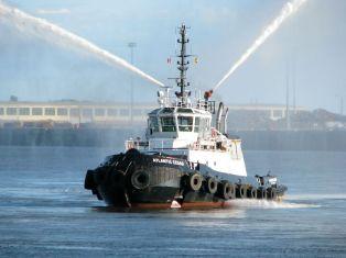 Spraying Tugboat