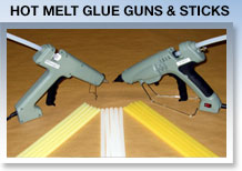 Hot melt guns used to apply the glue for unitizing the load.