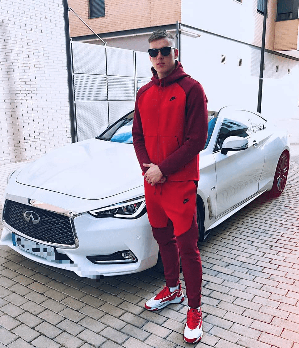 Lunin Standing In Front Of His Infiniti Car