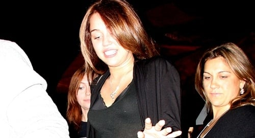 Miley Cyrus In A See-Through Shirt And Black Bra