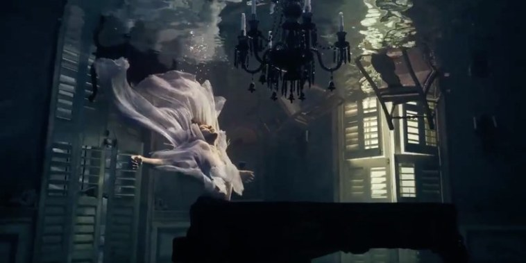 "Harry Styles at the piano with two ghosts in his music video for ""Falling"""