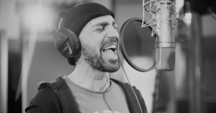 "Tornike Kipiani singing his Eurovision 2020 song ""Take Me As I Am"" into a studio microphone"