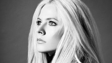 Black and white photo of Avril Lavigne's face as she's looking upwards
