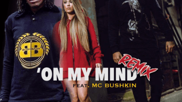 "The single artwork of ""On My Mind (Remix)"" with MC Bushkin on the left wearing a navy tracksuit, Michelle Platnum in the middle wearing a long-length red jacket and ITSALLABOUTAARON on the right dressed in black."