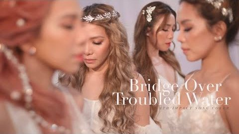 "YouTube thumbnail of the video of ""Bridge Over Troubled Water"" which sees the 4th Impact girls looking like goddesses, dressed all in white."