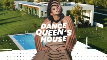"INNA posing with hands on hips wearing grey/brown trousers and a black bra with her head tilted up and to the right. In the background there is the pool and the house, and the words ""Dance Queen's House"" in white across INNA's chest."