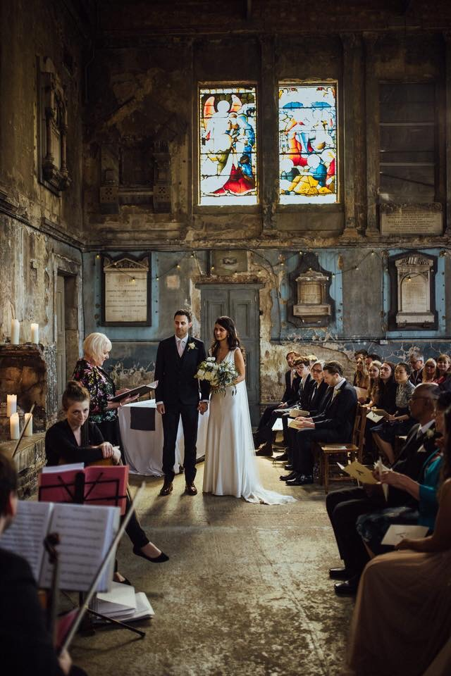 couple getting married in a ceremony with a Celebrant in a decommissioned church in Peckham London