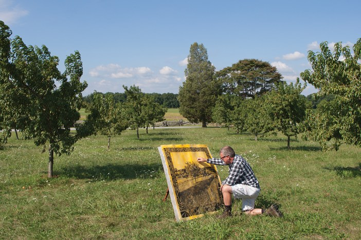 Mark Mahosky painting in the Peach Orchard