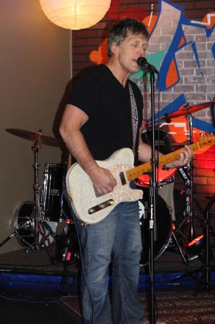 Jay, lead vocals & rhythm guitar