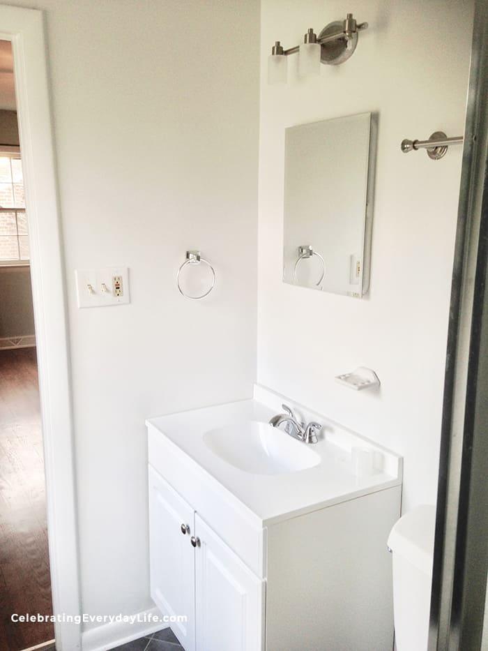 plain white bathroom vanity before home staging