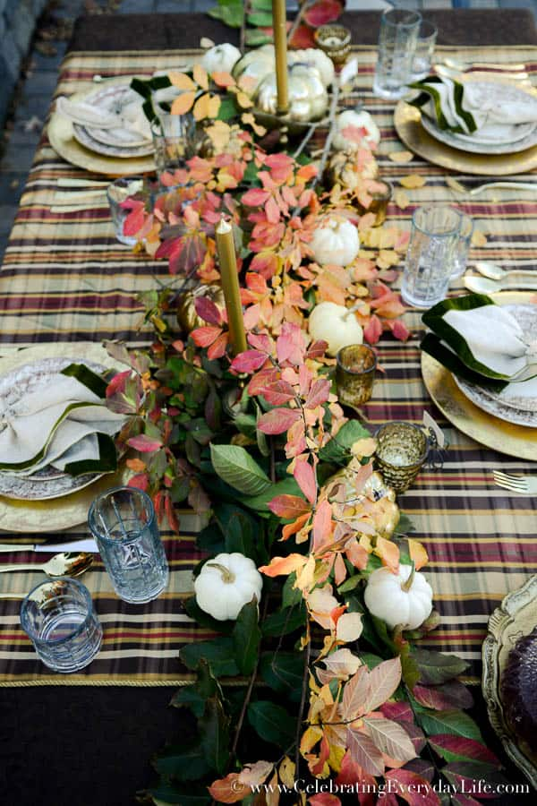 Outside Thanksgiving Table, Fireside Thanksgiving Table, Autumn tablescape, fall tablescape, plaid tablescape, gilded pumpkin table, fall leaf garland, fall leaf table, falling leaves table, outdoor fireplace table, Celebrating Everyday Life with Jennifer Carroll