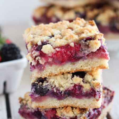 Mixed Berry Crumble Bars - Buttery crumb bars filled with fresh berries. The crust and topping is made from the same mixture, making this a quick and easy recipe!