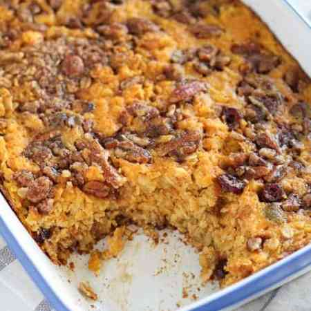 Pumpkin Spice Baked Oatmeal - Pumpkin, oats, brown sugar, cinnamon, pecans, and dried cranberries combine in this delicious make-ahead breakfast.