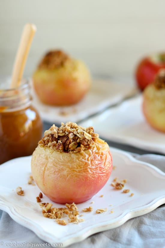 Baked Stuffed Apples - Tender baked apples stuffed with a sweet cinnamon-oat crumble. Served warm with vanilla ice cream and caramel sauce.