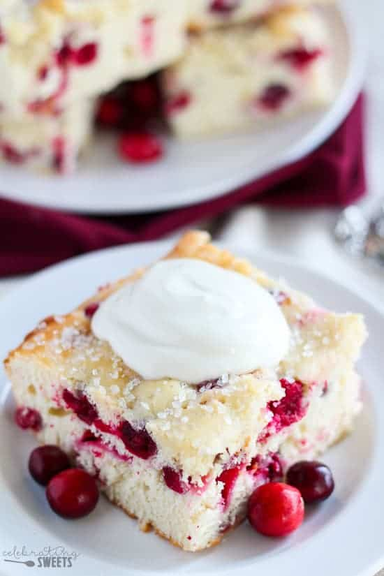 Easy Cranberry Vanilla Yogurt Cake - Take a shortcut with a boxed cake mix for this easy and festive vanilla cake studded with fresh cranberries.
