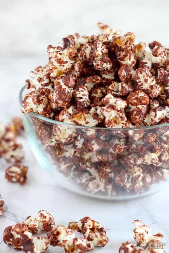 Dark Chocolate Sea Salt Popcorn Recipe | Celebrating Sweets - A healthy sweet and salty snack made of popcorn tossed with melted dark chocolate and sprinkled with sea salt. Part dessert, part snack - completely delicious!