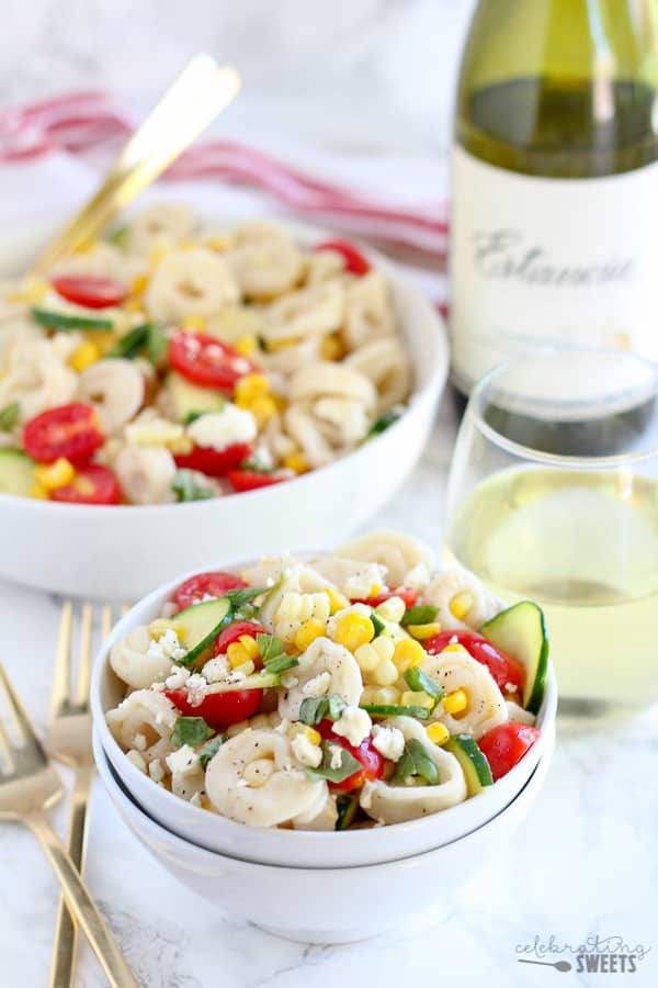 Summer Corn , Tomato and Tortellini Pasta Salad - A summery pasta salad filled with cheese tortellini, corn, tomatoes, zucchini and basil topped with a fresh lemon vinaigrette. Serve chilled or at room temperature.