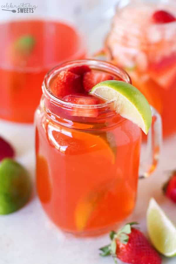 Strawberry Lime Shandy - A light and refreshing beer cocktail made with Corona Light, strawberry syrup and fresh lime juice. The perfect beverage for Cinco de Mayo or any spring or summer occasion!
