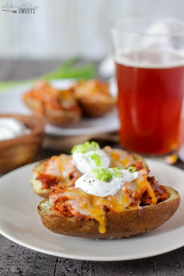 Stuffed Potato Skins - Hearty potato skins filled with BBQ pulled pork and topped with cheese. The perfect game day meal or snack!
