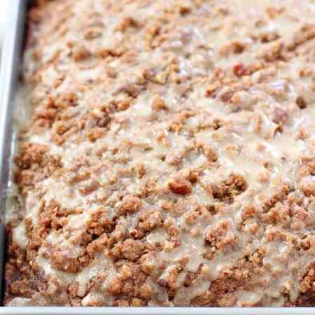 Maple Gingerbread Coffee Cake - Tender spiced Gingerbread Cake topped with a brown sugar pecan streusel and maple icing. The perfect coffee cake for breakfast or dessert. Holiday flavors in every bite!