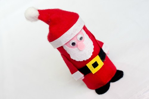 Step by step tutorial with photos for a cute felt Santa.
