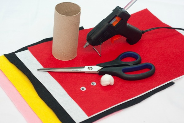 Materials required for a cute felt Santa toilet paper roll craft.