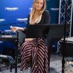 LeAnn Rimes in H&M long satin jacket and Flynn Skye wrap chevron stripe skirt while performing on SiriuxXM March 6, 2017