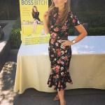 Nicole Lapin in Dolce & Gabbana Rose Print Peplum Hem Dress at Wealthy Girl Summit (Instagram March 31, 2017)