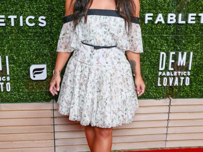 Demi Lovato in Giambattista Valli Pleated Tiered Mini Dress at the launch of her Fabletics Capsule Collectionon in Los Angeles, CA on May 10, 2017.