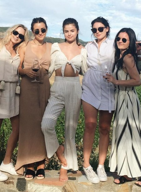 Selena Gomez in Stone Cold Fox Haven Crop Top and Stone Cold Fox Isla Trousers in Pinstripe Linen on her friend Raquelle Stevens' Instagram July 16, 2017.