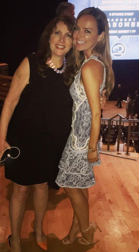 Nicole Lapin poses with PR wizard Laurie Goldberg on Instagram (July 20), wearing a Jonathan Simkhai Two-Tone Lace Ruffle Hem Minidress.
