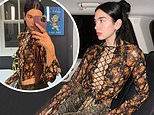 Dua Lipa turns up the heat as she flaunts her cleavage in a racy tie-up top and vinyl trousers