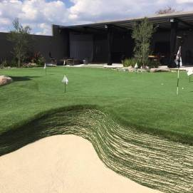 stacked sod bunker in private golf green