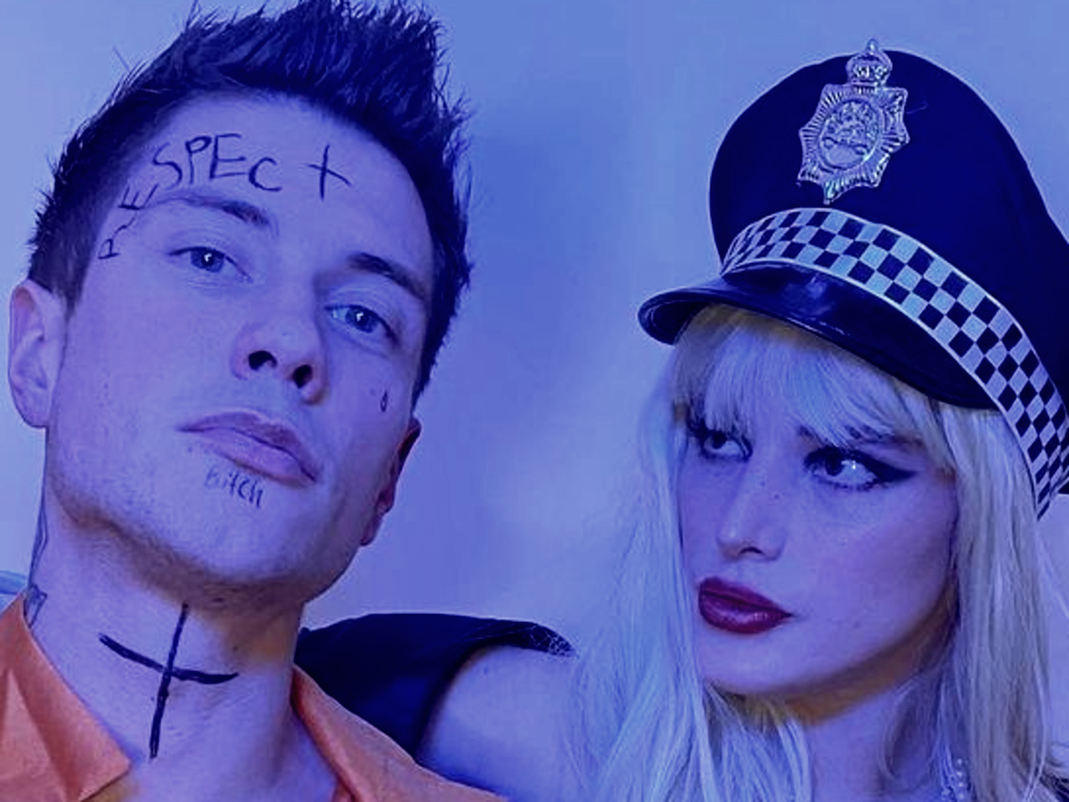 """""""bella-thorne-licks-a-gun-as-she-dresses-up-as-a-cop-for-halloween-and-breaks-her-boyfriend-out-of-jail"""""""