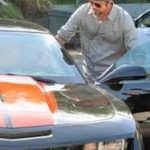 Brad pitt with Chevy Camaro SS image.