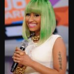 Nicki Minaj tattooed a chinese line on her biceps which means God is with me.