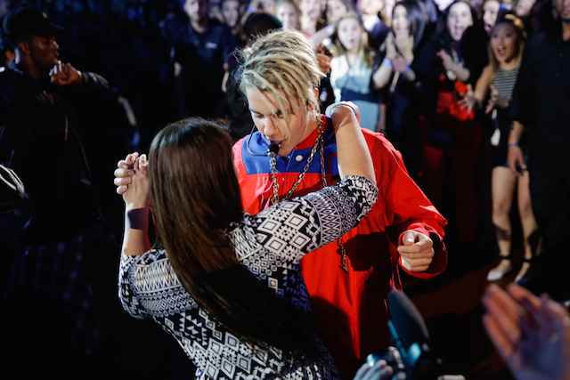 Justin Bieber and a lucky fan dancing during his performance at the 2016 iHeartRadio Music Awards. (photo courtesy: Andrew Swartz for iHeartRadio)