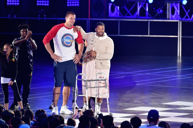 NFL player Rob Gronkowski (L) and host Russell Wilson speak onstage during the Nickelodeon Kids' Choice Sports Awards 2016 at UCLA's Pauley Pavilion on July 14, 2016 in Westwood, California. Photo: Dave Mangels/Getty Images