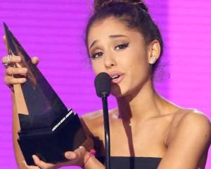 Ariana Grande accepts the award for favorite female artist - pop/rock at the American Music Awards at the Microsoft Theater on Sunday, Nov. 22, 2015, in Los Angeles. (Photo by Matt Sayles/Invision/AP)