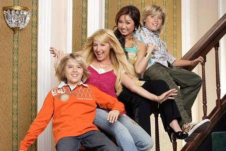 Cole Sprouse, Ashley Tisdale, Brenda Song and Dylan Sprouse sitting on a stair handle for The Suite Life Of Zack and Cody.