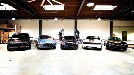 The Chrysler 300 SRT8 takes center stage with the 2013 Ford Flex, the Tesla Model S, the Dodge Challenger Hellcat and the Trans-Am on its either sides.