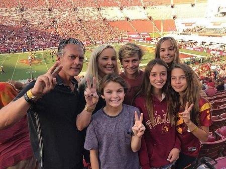 Shannon Beador, David Beador and their daughters with a boy guest peace sign and smiling while watching watching USC play football dated October 14.